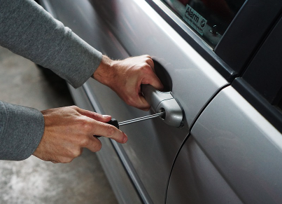Car Theft - Door lock being picked.